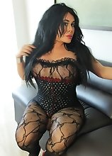 Busty Brunette in Lace Fishnets and Corset