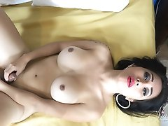 Young Tranny with a VIBRATOR in her BUM HOLE