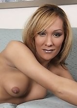 This leggy beautiful tgirl has a great smile and a huge pair of hormone tits!