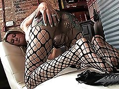 Rock hard Morgan jerks in fishnets