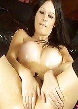 TS Hannah Sweden oils her tits and asshole