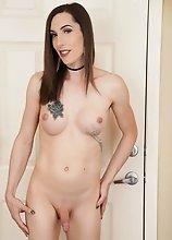 Melanie Brooks is stunning! Watch her posing, stripping, stroking her cock and fucking her tight ass with her vibrator!