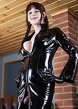 Huge Tits European shemale in black leather and latex boots